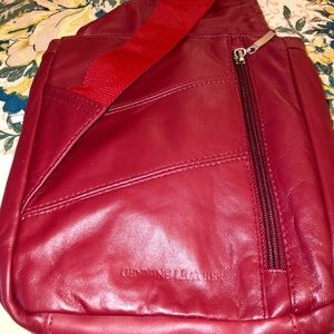 Buxton soft red leather cross body travel bag